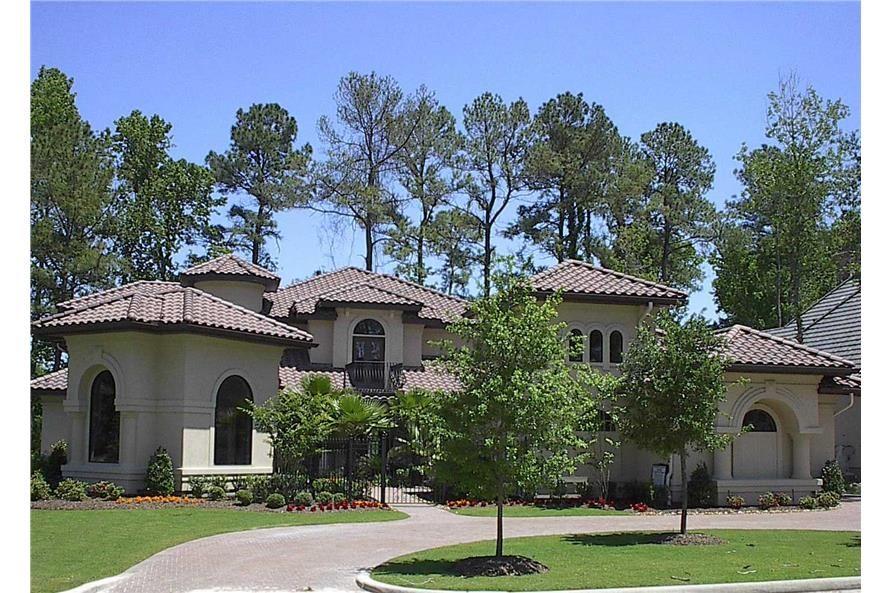Photo of exterior of this Spanish Mission style home.