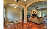 This is a color photo of the front of these Acadian House Plans.