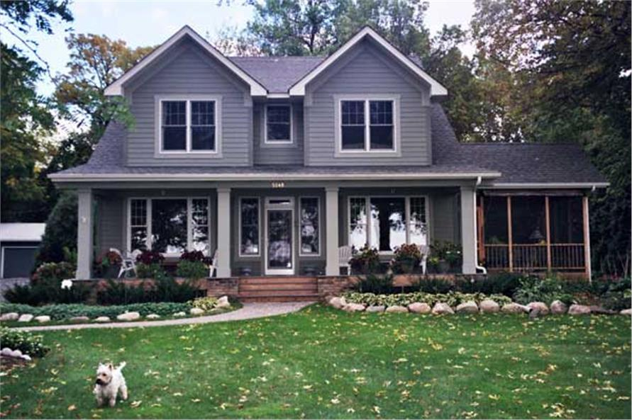 Elevation photo of Country House Plans CLS-3215 with a cute little dog.