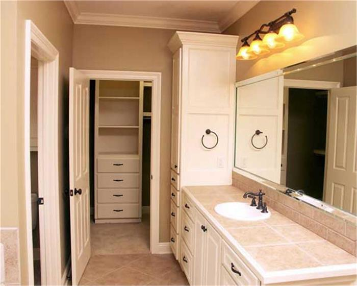 Photo of a walk-in closet off of a bathroom (Plan #141-1072)