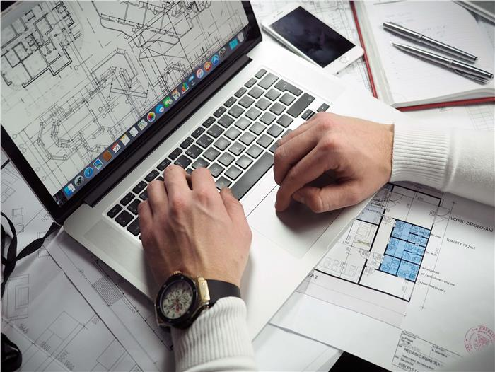 Architect on PC Laptop Working on Blueprints - CAD File