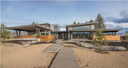 Striking home in the Mid-century Modern style with sleek design, floor-to-ceiling glass, and generous amounts of covered outdoor living space